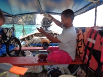 Our longtail skipper preparing his fishing line - he caught 2 red tuna for his family's supper